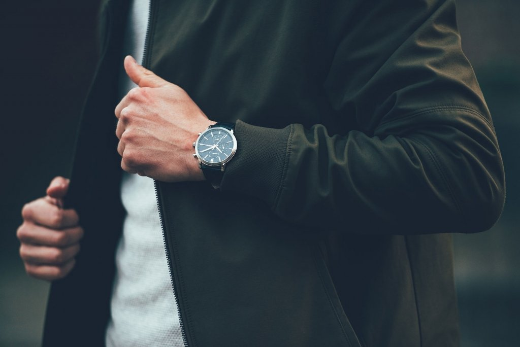 Photo of a busy man wearing a watch